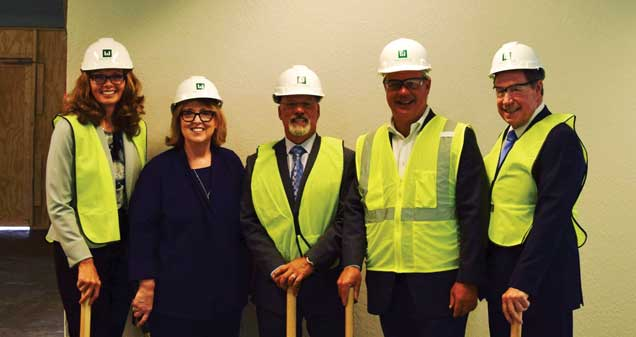 Maureen Widner, AIHS COO; Connie Benton Wolfe, AIHS President & CEO;  Dr. Greg Johnson, Parkview Health; Larry Weigand, Weigand Construction; Keith Huffman, AIHS Board Chair.