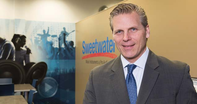 Doug Wood, Senior Vice President Chief Administrative Officer of Sweetwater and Chairman of JANI Board of Directors, stands in front of the Sweetwater Entertainment shop in Lincoln Finance Park.