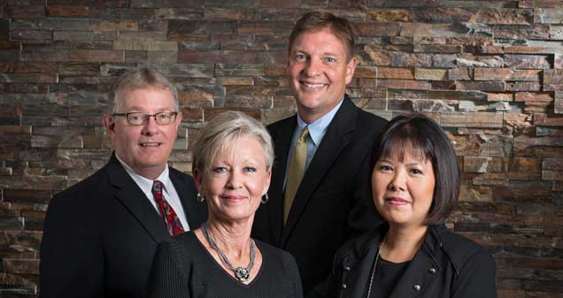 Front: Jill R. Keim, vice president, relationship manager and Yen T. Nguyen, mortgage consultant. Back: David A. Fee, vice president, senior trust advisor and William H. Thatcher, regional president