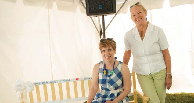 Patti Hays, AWS Foundation CEO and Buddy Bench honoree (seated), Vicki Junk-Wright, bench artist (standing)