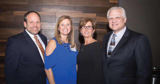 Terrell, his wife Colleen Terrell, Chief Development Officer Brenda Gerber Vincent and long-time board president, Jeff Cybulski